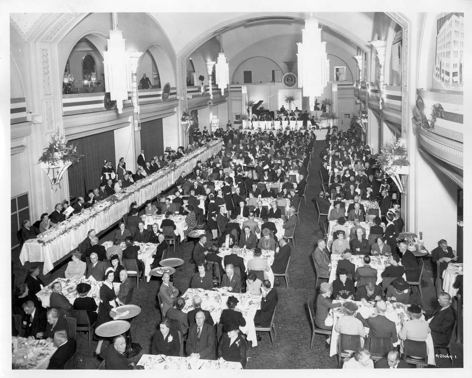 vintage 1944 photo of employees gathered for Liberace performance at arcadian court