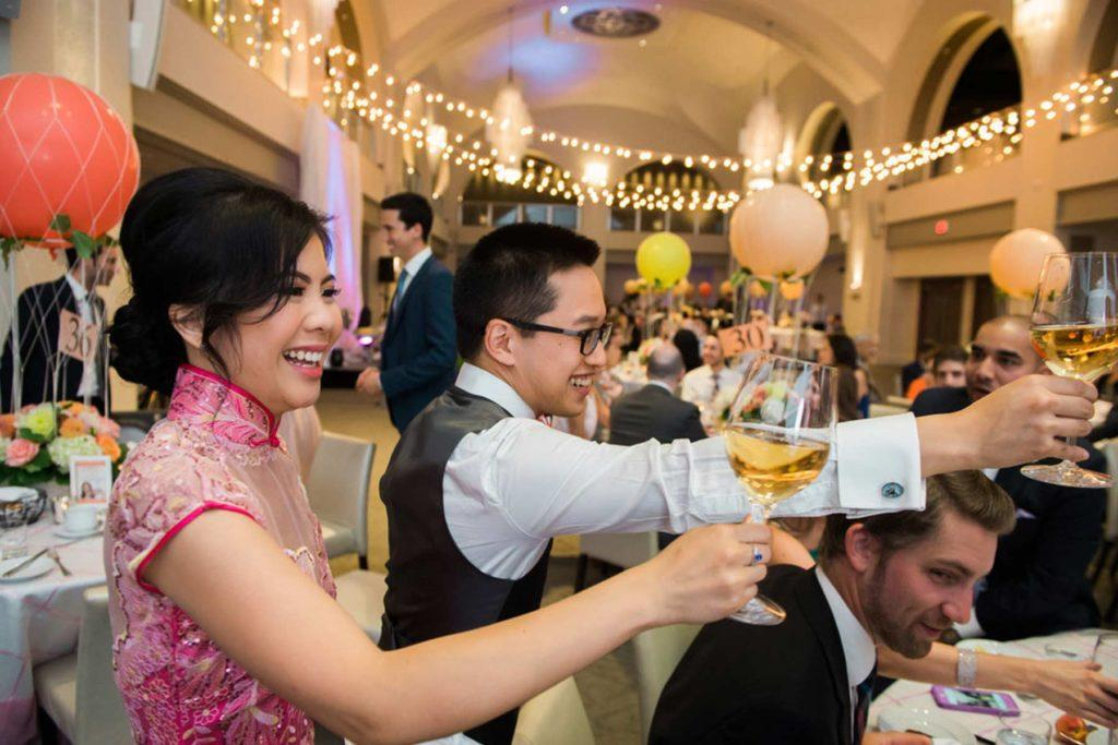 Guests raising their glasses of wine at a wedding reception at Arcadian Court