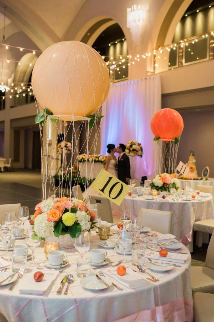 Balloon and floral centerpieces with table numbers at Arcadian Court