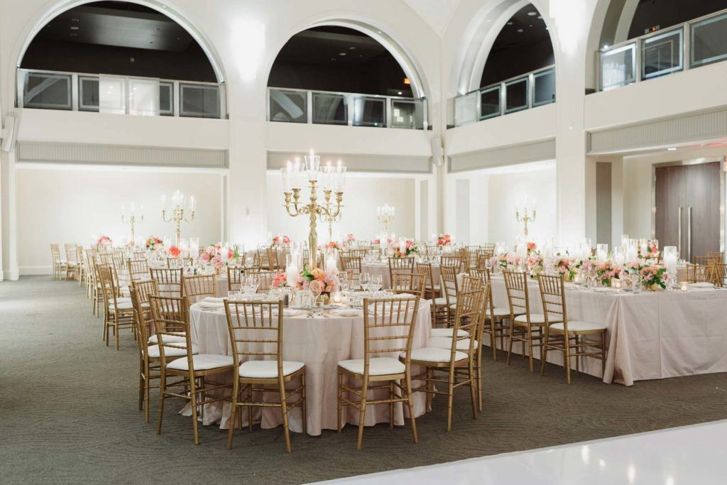 Gold chairs and table settings at wedding reception in Arcadian Court in Toronto