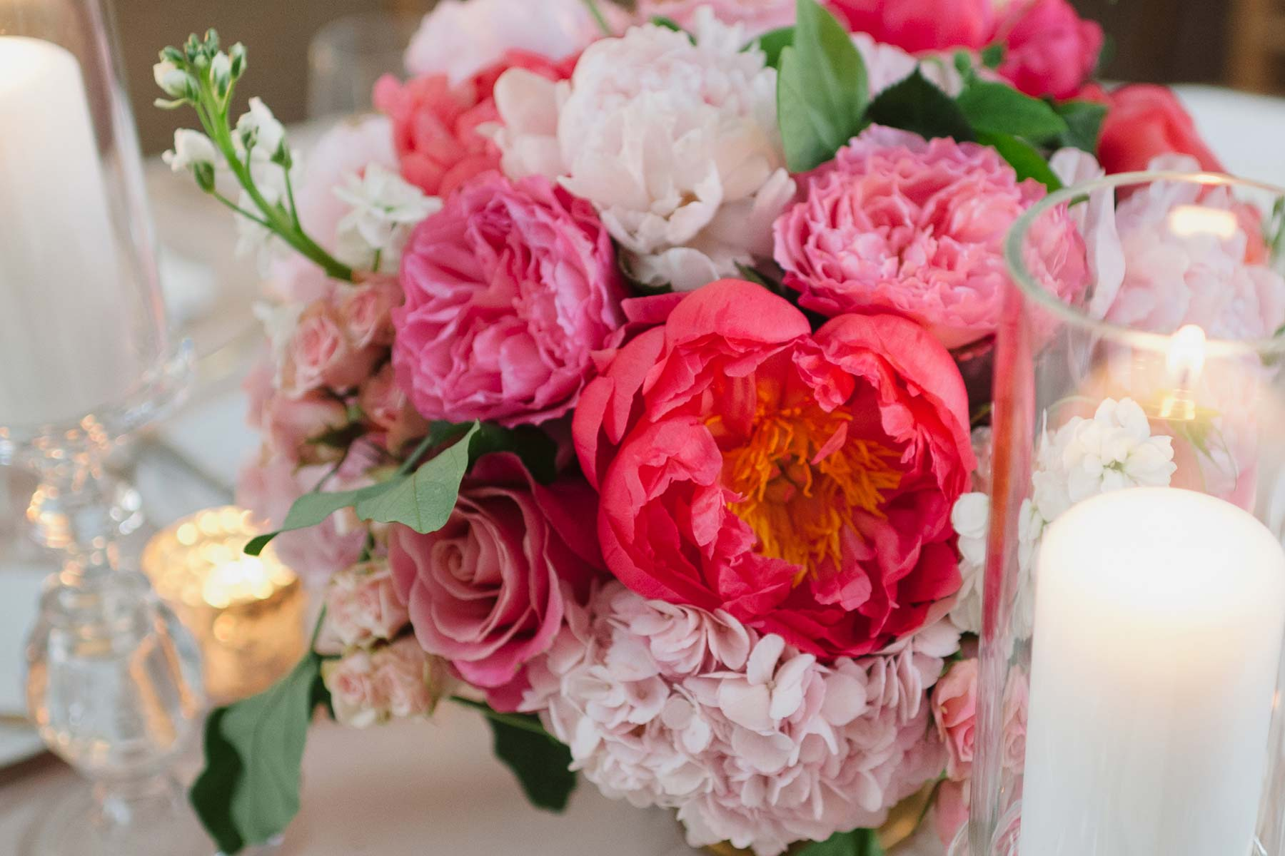 Lush pink floral arrangement and candle centerpiece at Arcadian Court