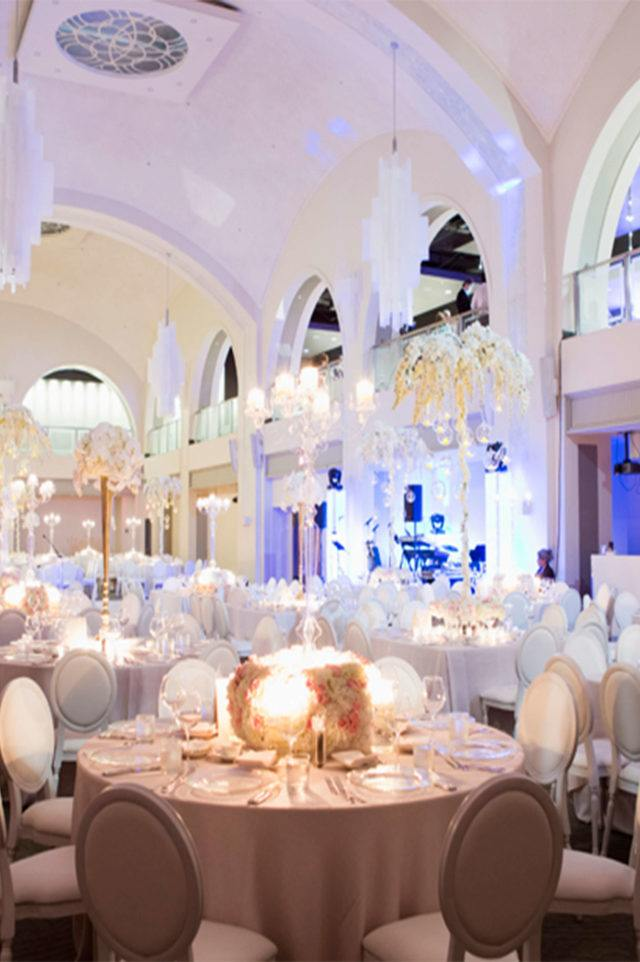 several tables set up for wedding at arcadian court event venue