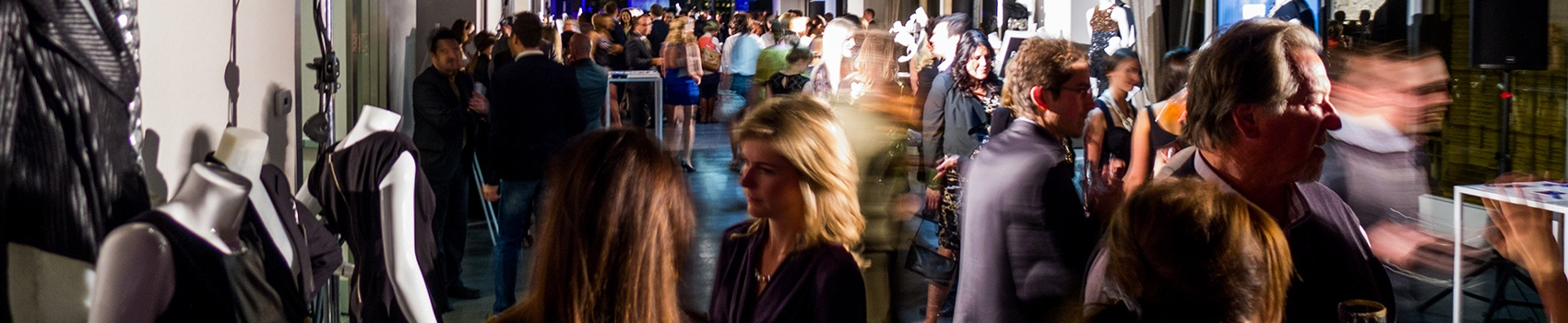 several people conversing at event reception at Arcadian Loft