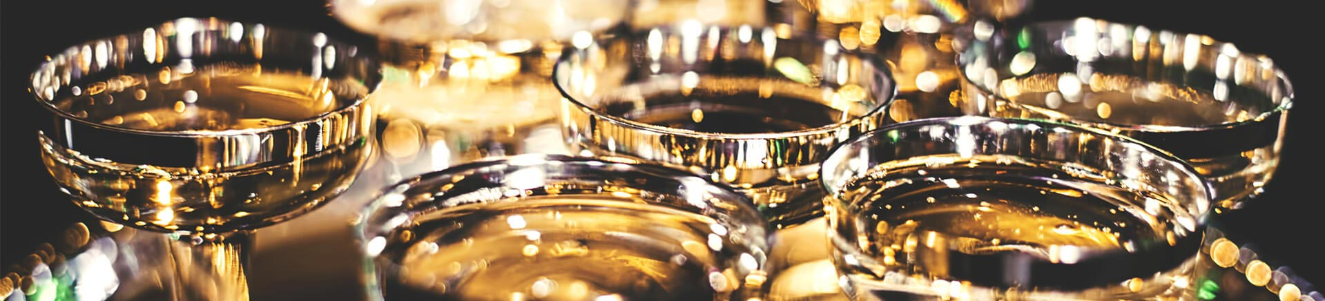 tray of sparkling gold champagne glasses
