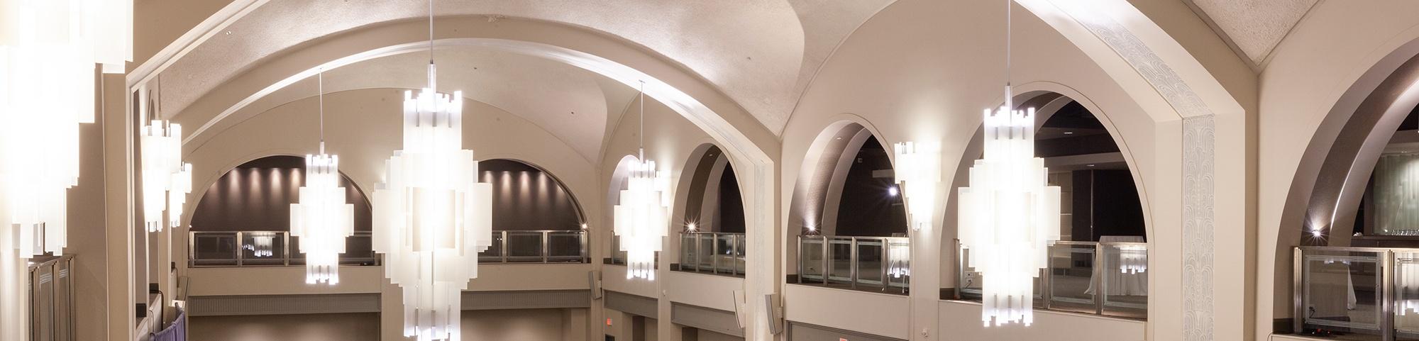 arcadian loft event venue space with big lit chandeliers