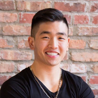headshot of Chef Eric Chong standing against a brick wall
