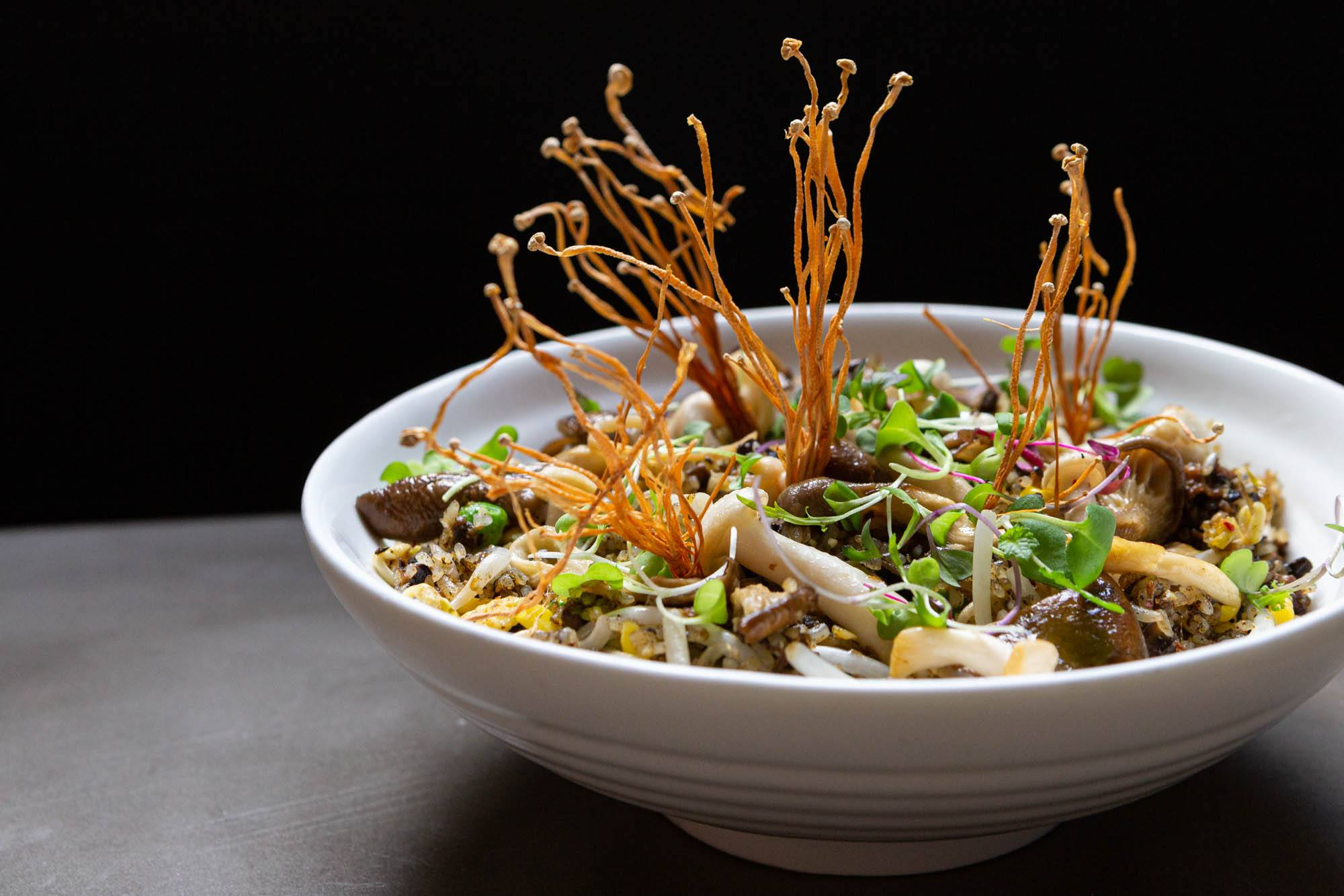 R&D Fried Rice, smoked portobello, XO duxelles, chinese olive leaf, egg, peas, corn