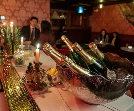 Bottles of bubbly sitting on the bar at Sous Sol in Toronto