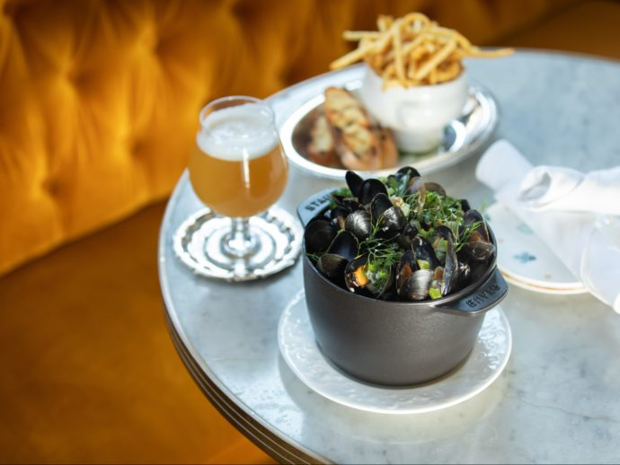 Mussels and fries on a table