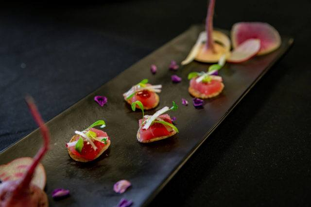 Beautiful shot of black ceramic serving dish with canapes at The Carlu event venue in Toronto