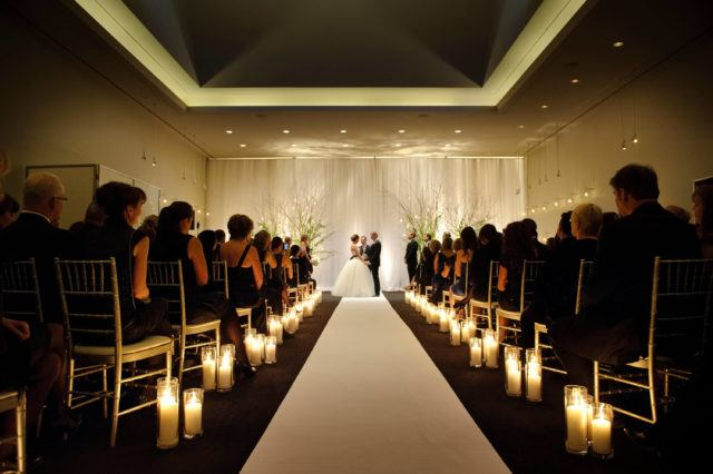 people watching wedding ceremony at the Sky Room in The Carlu event venue in Toronto