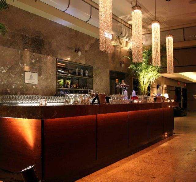 the luxurious carlu bar with long hanging chandeliers