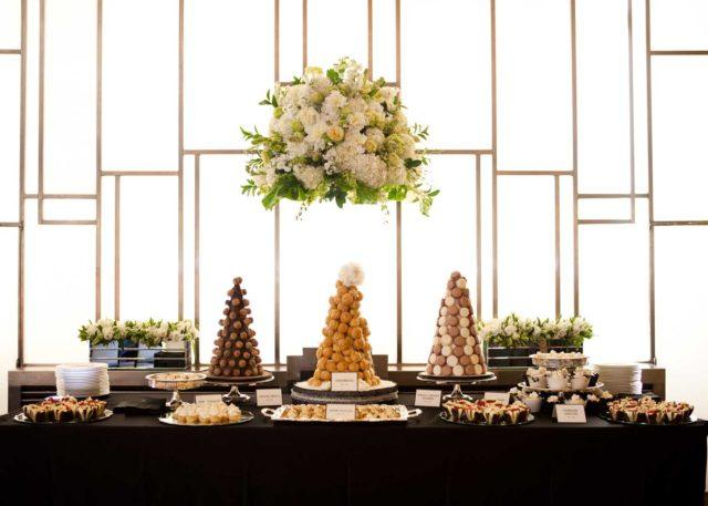 a luxurious dessert table at a wedding at The Carlu in Toronto
