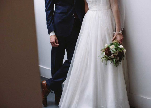 bride and groom's wedding attire from the neck down