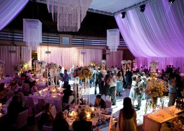 couples dancing at a wedding in the beautiful Carlu ballroom while guests at tables look on