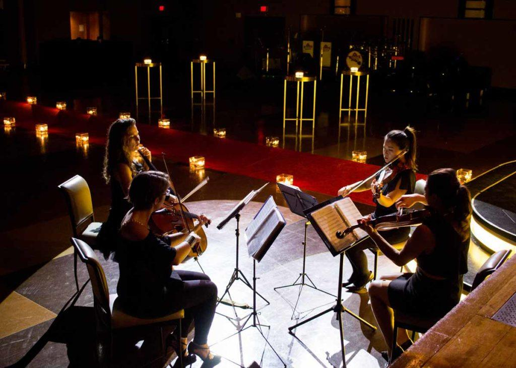 a live concert on the stage in the Concert Hall at The Carlu Toronto