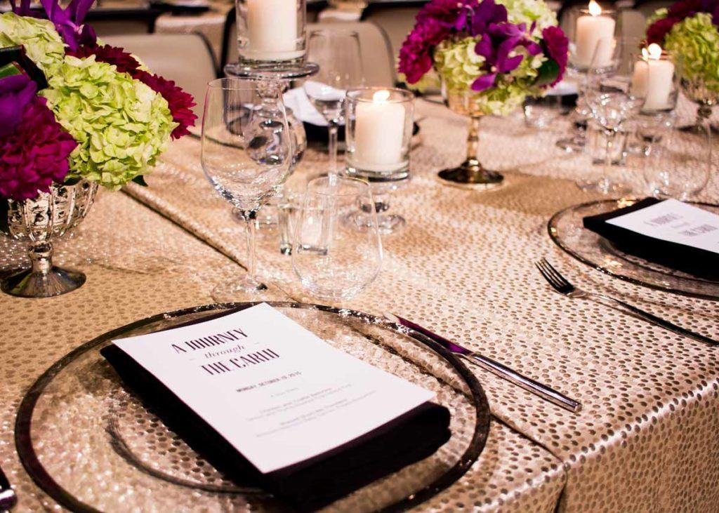 Plate settings and dinner menu on a table at The Carlu event venue in Toronto