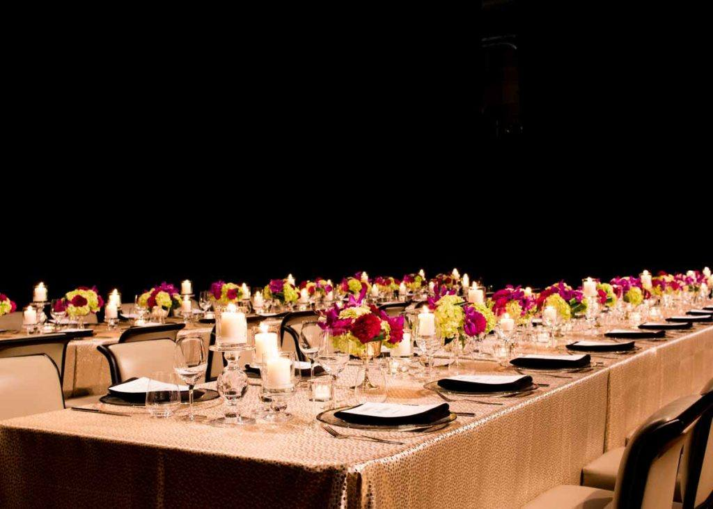 Beautiful tablescape and place settings at a formal dinner in the Concert Hall at The Carlu