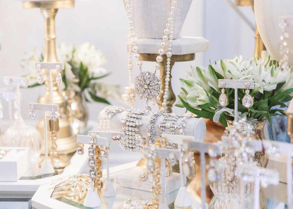 A display of earrings, bracelets, necklaces and other jewelry at the Toronto WedLuxe Wedding Show