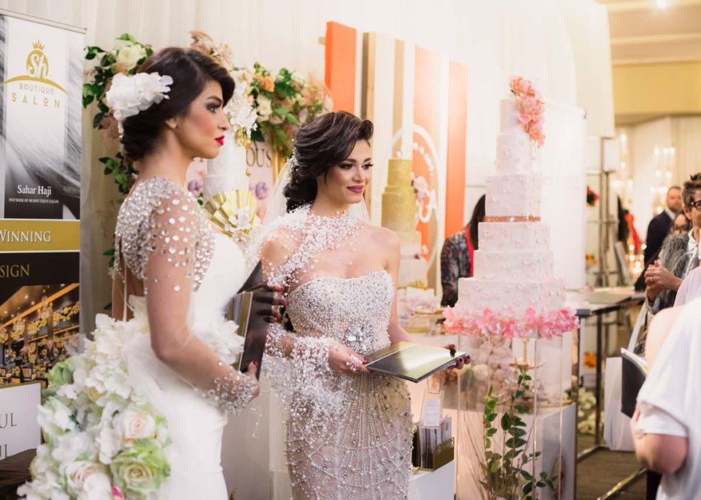 Models dressing in wedding gowns at the Toronto WedLuxe Wedding Show at The Carlu