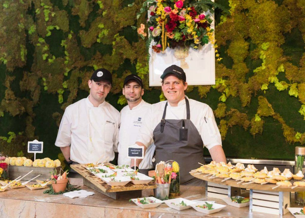 Oliver & Bonacini catering team working at the WedLuxe Wedding show at The Carlu