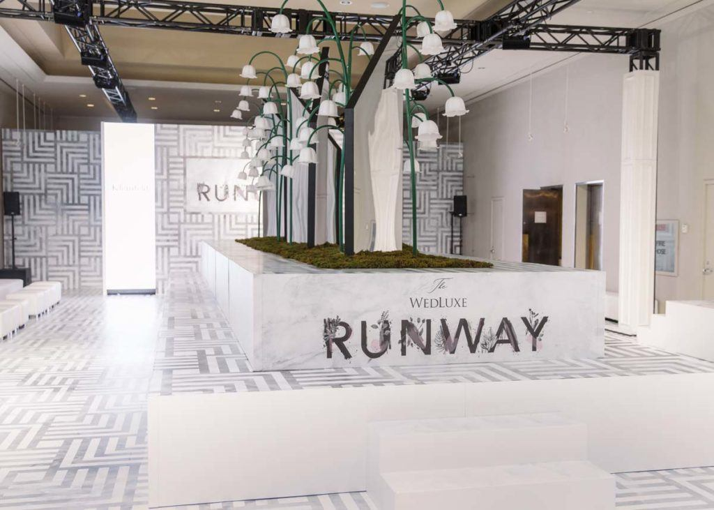 The fashion runway set up at the Toronto WedLuxe Wedding Show at The Carlu