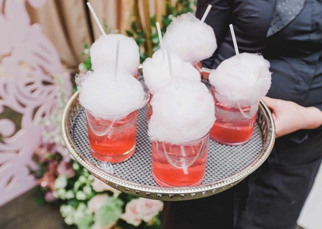 Cotton candy cocktails on a serving tray at the Toronto WedLuxe Wedding Show at The Carlu