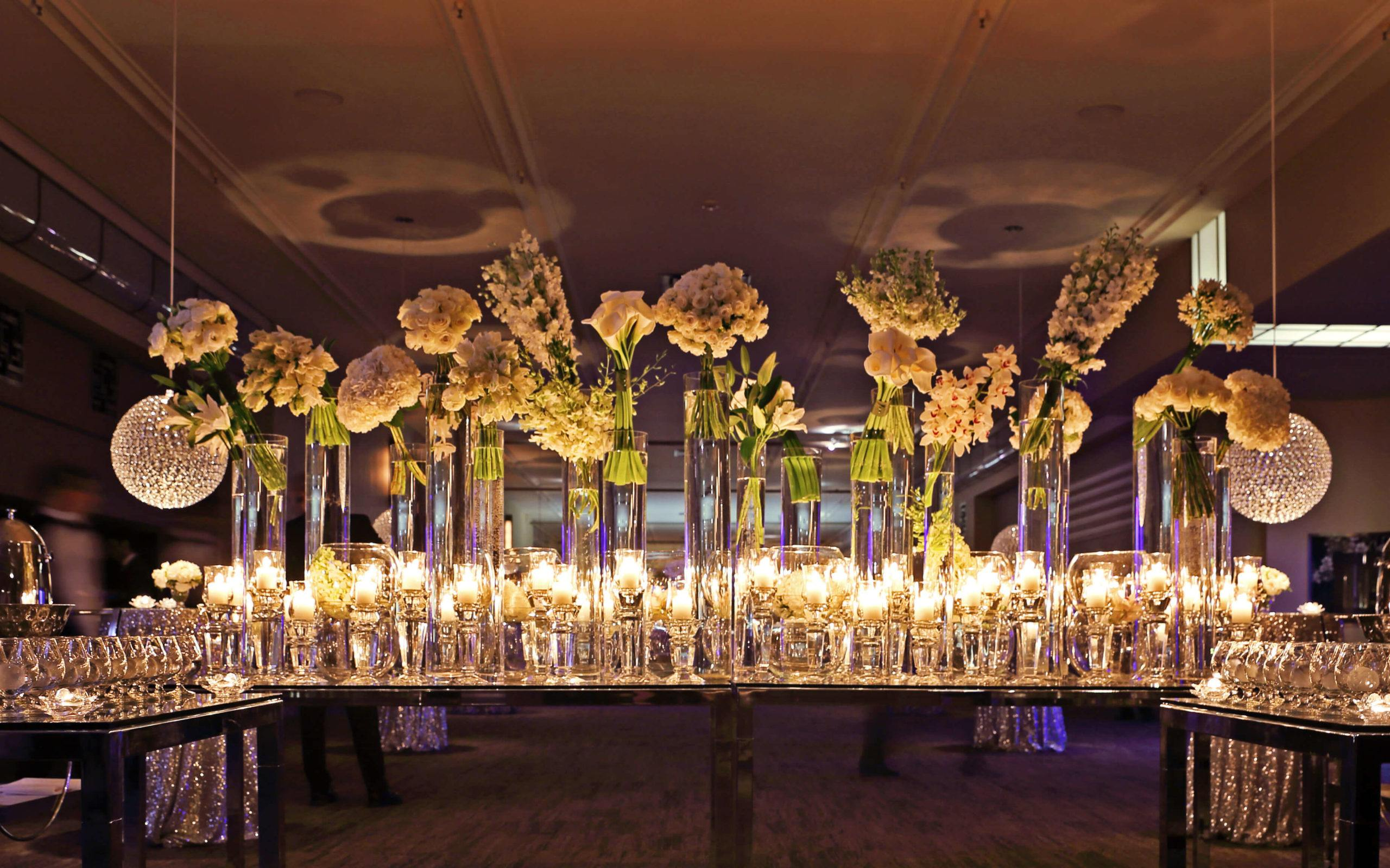 glasswares and lit candles set up along the tables in the lobby at The Carlu