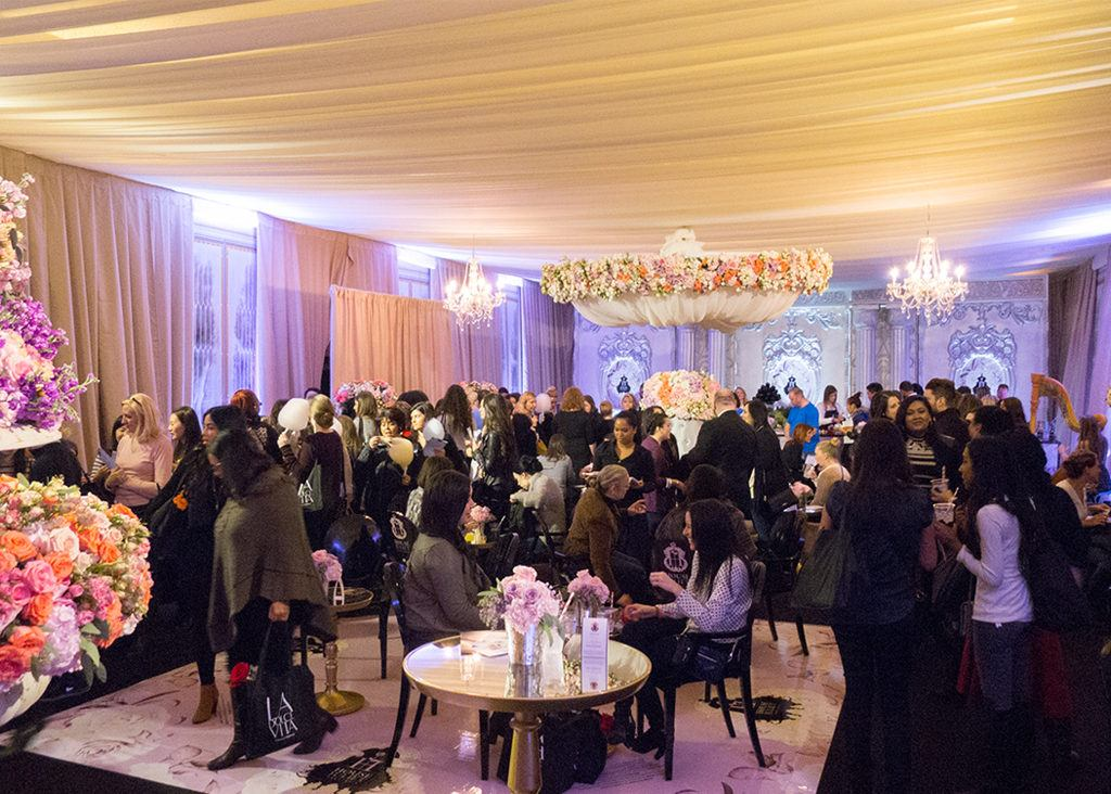 Guests mingling at a reception in the Sky Room event space at The Carlu