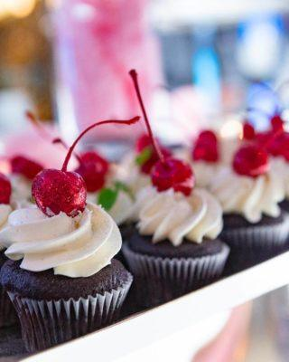 Chocolate cupcakes topped with glittery cherries at The Carlu