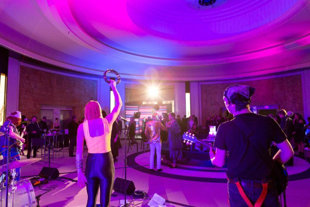 Live rock band performing in the Round Room at The Carlu