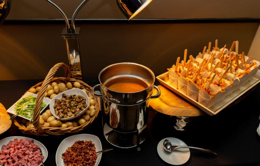 Poutine station with gravy, cheese curds, mushroom, bacon