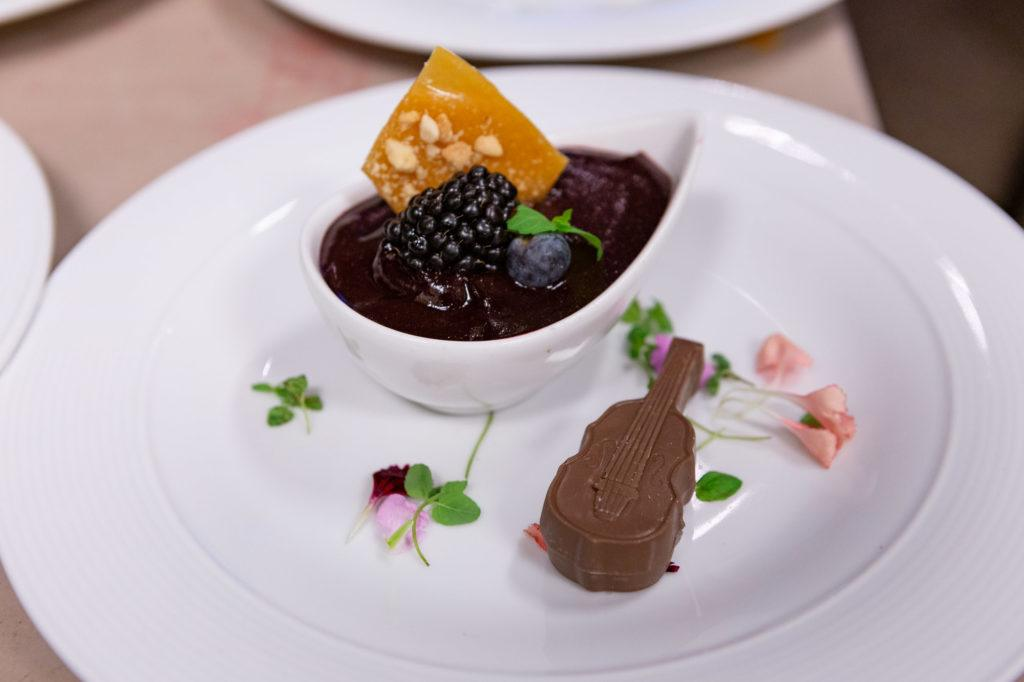 Plated dessert with a chocolate shaped violin