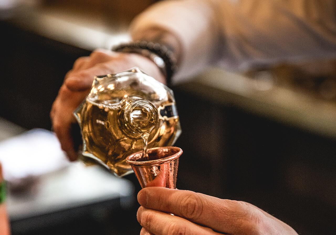 Bartender pouring drink at Braven bar