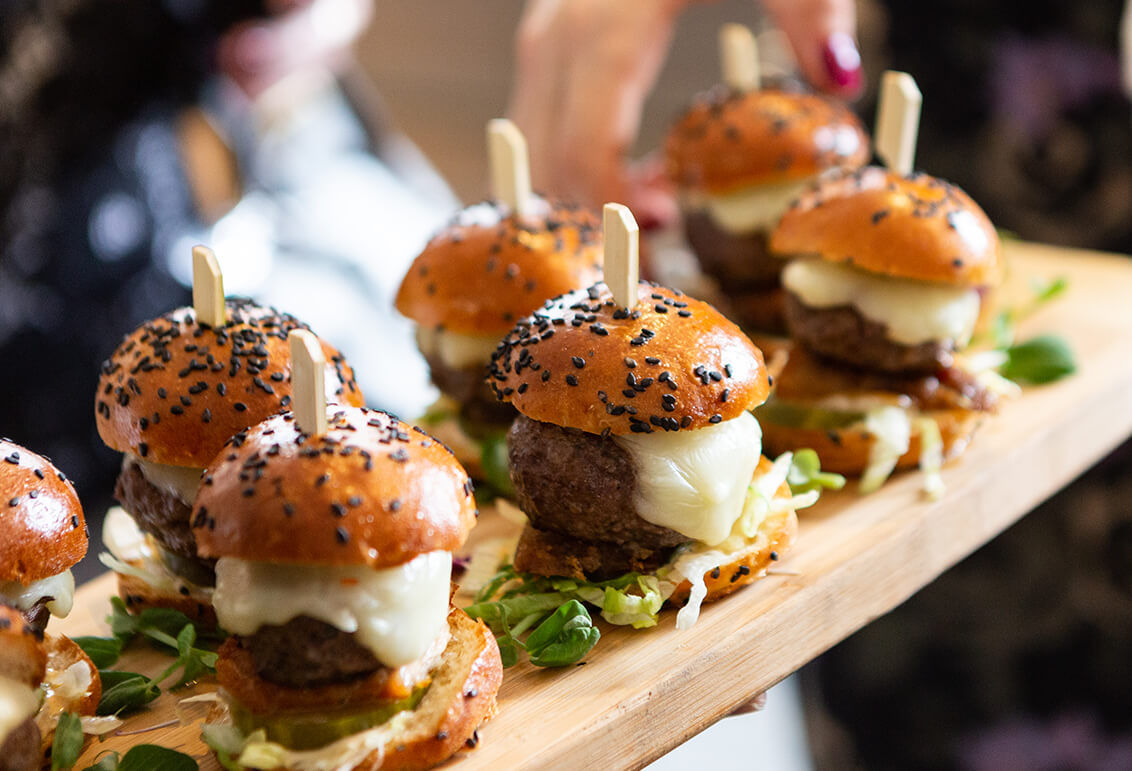 beef sliders on wooden serving platter