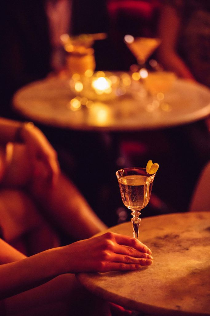 woman holding cocktail in lounge