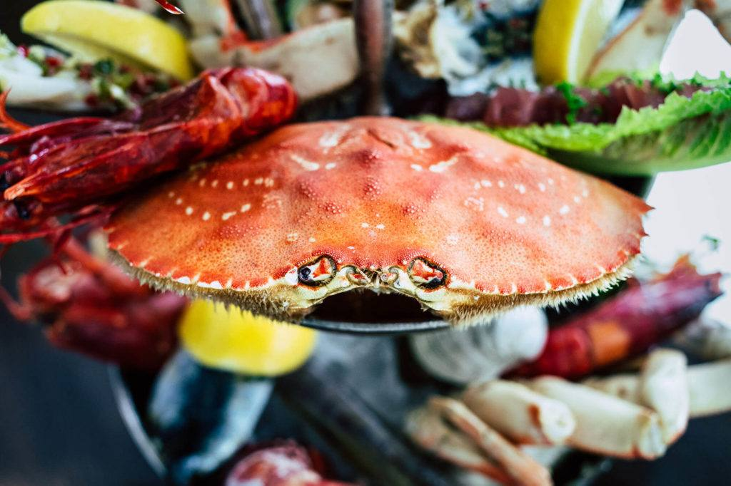 crab sitting on seafood tower