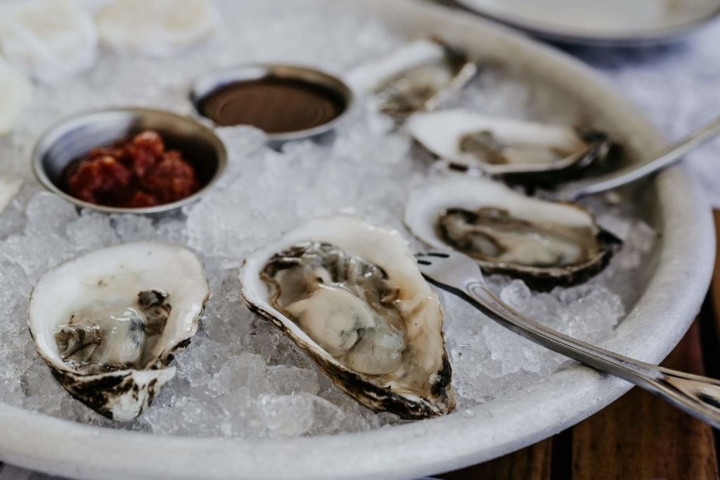 Platter of oysters on a wooden table