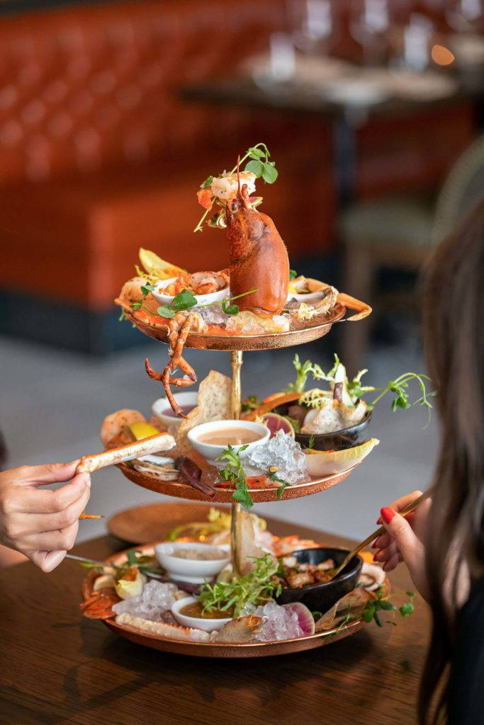 people eating from seafood tower