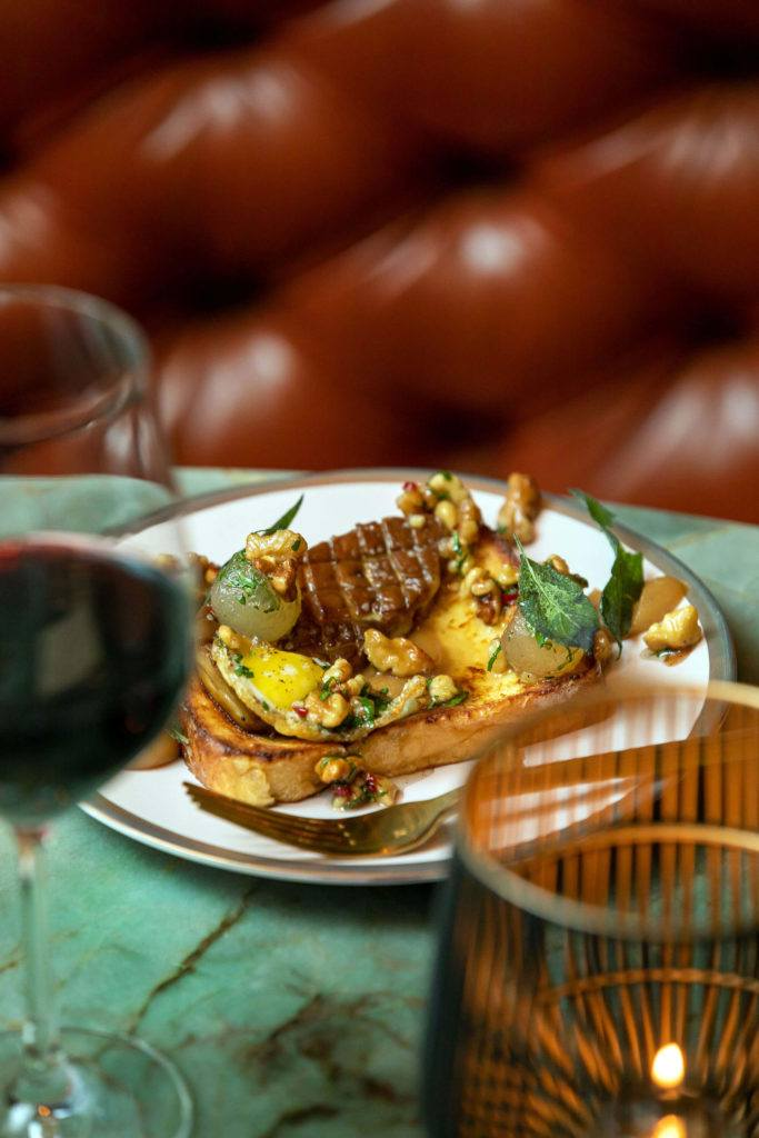 seared foie gras on toast against leather background