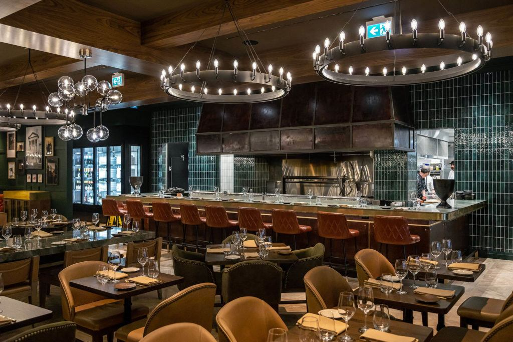 wide shot of chef's rail and dining space in Braven restaurant