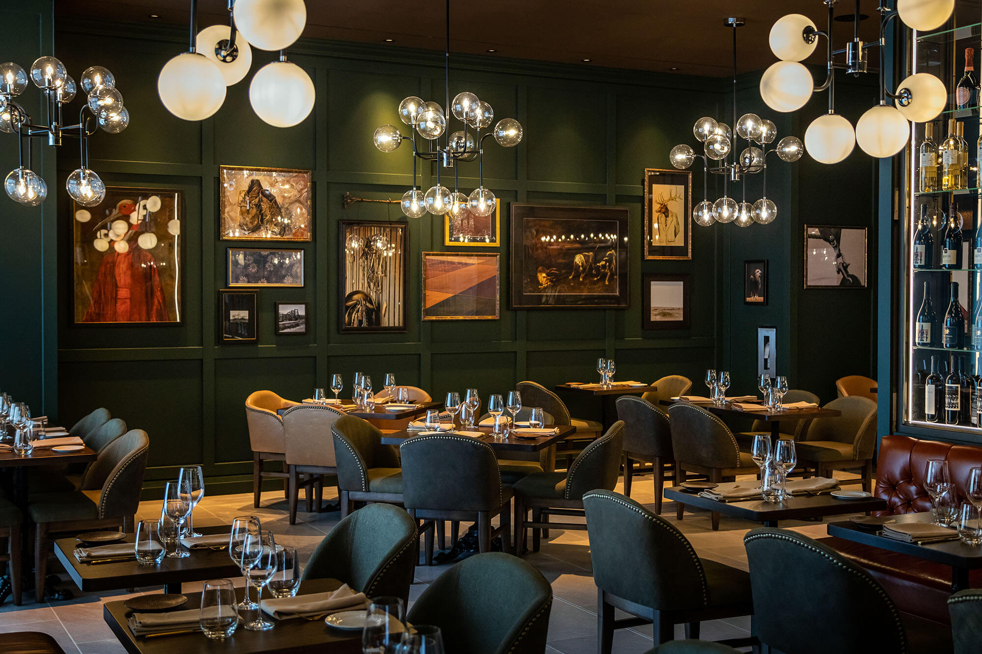 wide of Braven restaurant dining space with gallery wall