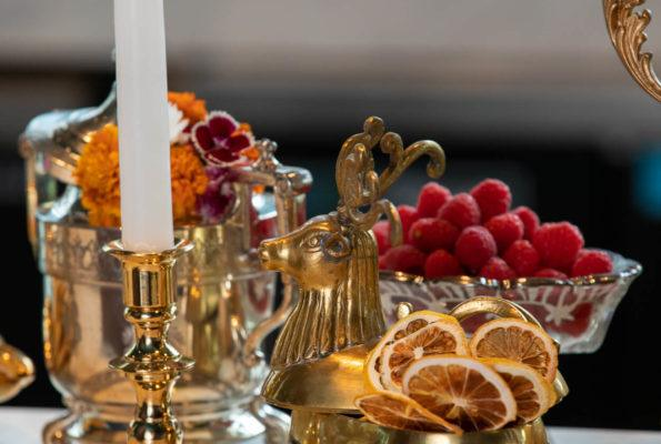 Alchemy bar topped with fresh fruit, dried citrus, candlesticks and decorative pieces.