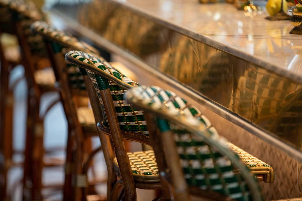 Green and white woven bar stools at the Alchemy bar in downtown Edmonton