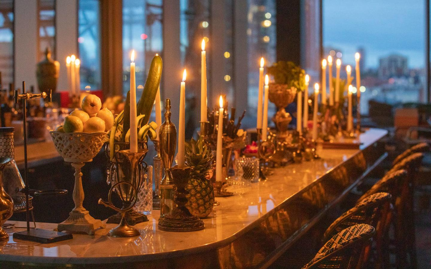 Alchemy bar lined with candles at dusk in downtown Edmonton