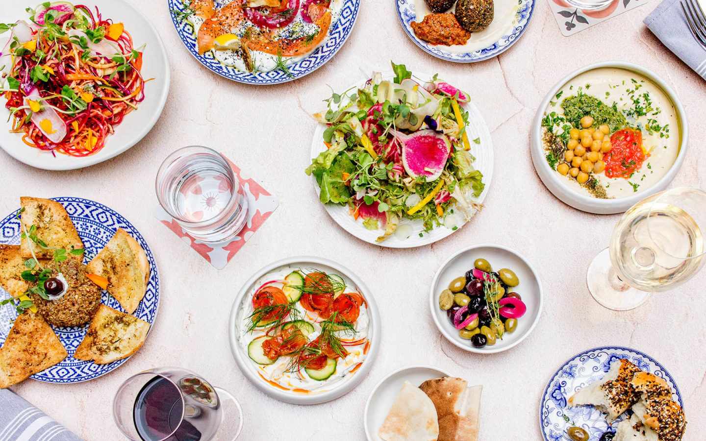Flaylay of salads, hummus, falafel and vine leaves at Babel in North York