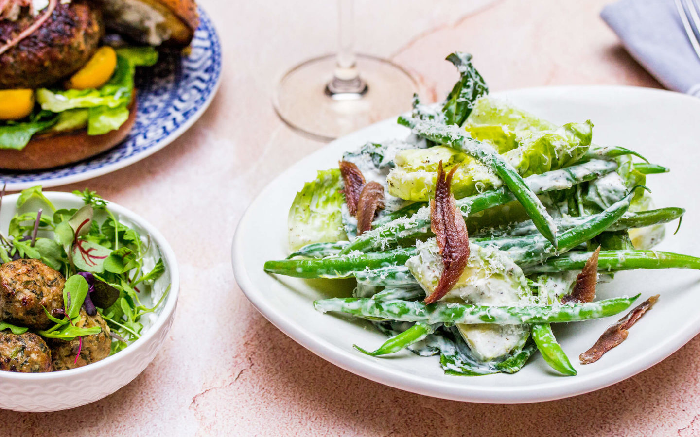 green bean & avocado caesar, romaine, garlic, anchovy, feta caesar dressing