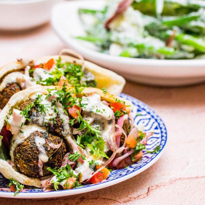 falafel pita, pickled onion, hummus, tomato, cucumber, sesame