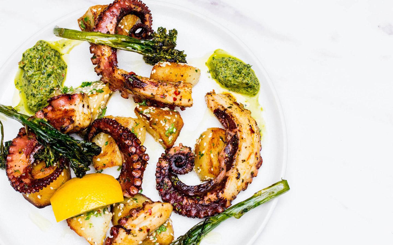 grilled octopus, sesame garlic potatoes, green harissa, spinach