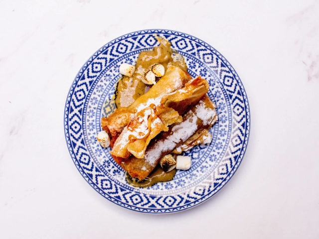 sweet potato spring rolls garnished with marshmallow and maple syrup